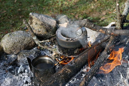 boil water: in the kettle on the fire to boil water