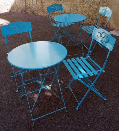 round chairs: blue round tables and chairs Stock Photo