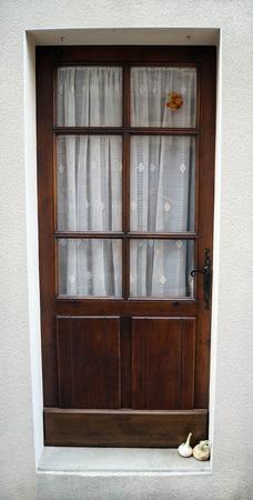 doorstep: brown door with garlic on the doorstep