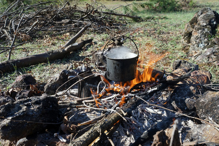 boil water: the fire to boil water for tea Stock Photo