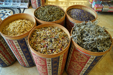 dried herbs: dried herbs in colored barrels