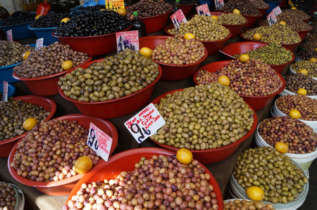 basins: varieties of olives in the basins on the market Stock Photo