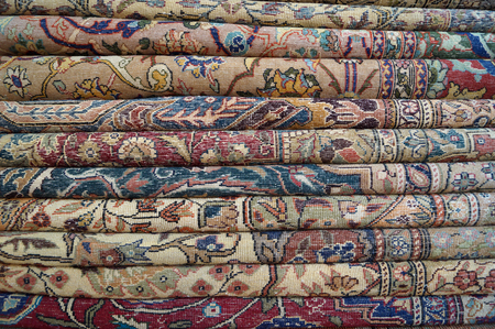wool rugs: stacked for sale Turkish carpets