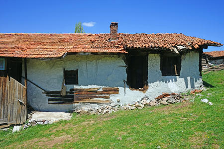 collapsing: an old house with a collapsing roof