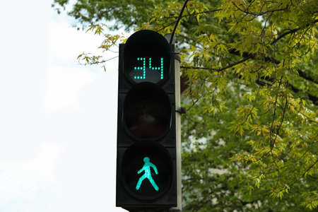 Modern traffic light with timer in city Stock Photo