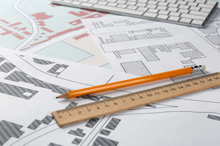 Pencil and ruler on cadastral maps of territory with buildings Reklamní fotografie