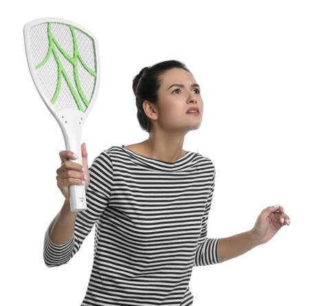 Young woman with electric fly swatter on white background. Insect killer