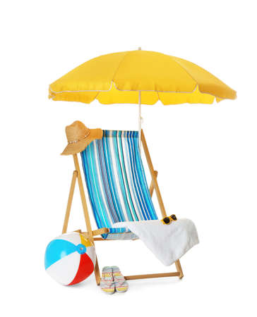 Open yellow beach umbrella, deck chair, inflatable ball and accessories on white background Archivio Fotografico