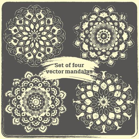 lotus effect: Set of 4 hand drawn mandalas. Vintage style elements with grunge effect.  Indian, asian, arabic, islamic, ottoman motif. Vector illustration.