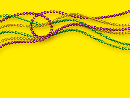 Mardi Gras beads in traditional colors. Decorative glossy realistic elements on yellow background. Copy space, top view. Vector illustration.