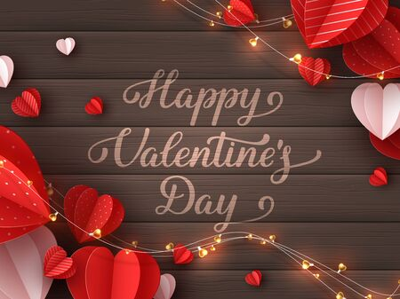 Happy Valentines day greeting card. Decorative paper cut hearts with garland and handwritten lettering text on brown wooden background. Vector illustration. 向量圖像