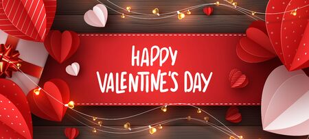 Happy Valentines day holiday banner. Decorative paper cut hearts, gift box, garland with handwritten lettering text on brown wooden background. Vector illustration. 向量圖像