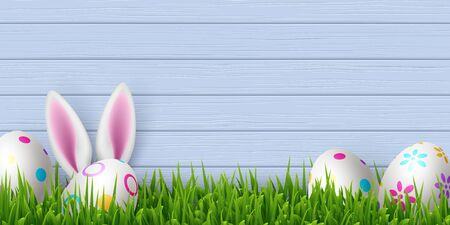 Vector Easter banner with painted eggs, green grass and cute rabbit ears. Blue wooden background with copy space. Spring holiday design. 向量圖像