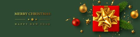Christmas horizontal banner with realistic red gift box, baubles, pine branches and gold tinsel. New Year vector illustration.