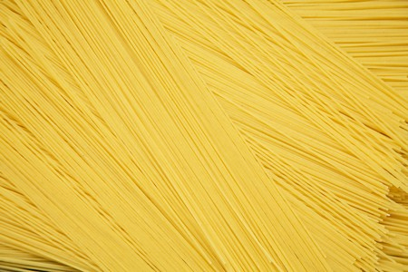 Spaghetti background. Texture. Long spaghetti. Raw spaghetti concept. Top view. Flat lay. From above.