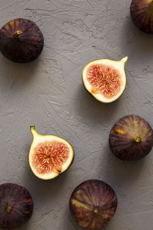Fresh figs on gray background, top view. Overhead, from above, top view.