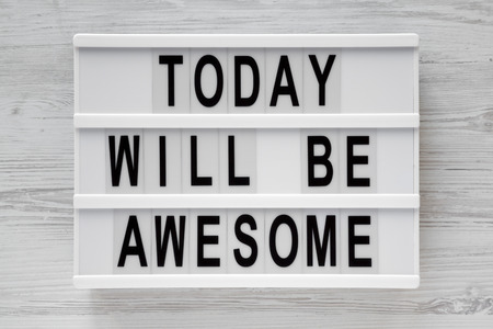 'Today will be awesome' words on lightbox over white wooden surface, top view. Overhead, flat lay, from above.