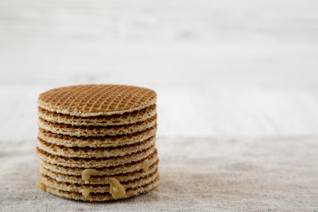 Stack of homemade Dutch stroopwafels with honey-caramel filling, side view. Copy space. Stock fotó