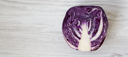 Red cabbage on a white wooden surface, top view. Overhead, from above, flat lay. Space for text. Zdjęcie Seryjne