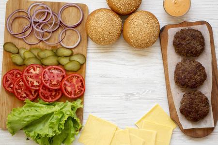 Frame of cheeseburger ingredients, top view. Imagens