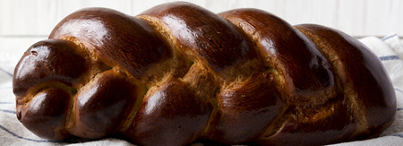 Homemade jewish challah bread, side view. Close-up. Stock Photo