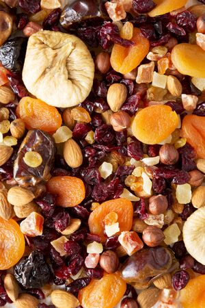 Dried fruits and nut mix background, top view. Close-up.