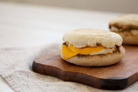 Homemade egg sandwich with cheese on a rustic wooden board, side view. Copy space. 写真素材