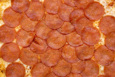 Tasty Pepperoni pizza background, top view. Overhead, from above, flat lay. Close-up. 版權商用圖片