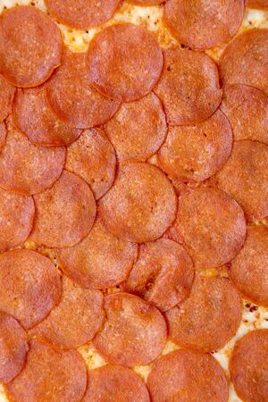 Delicious Pepperoni pizza background, top view. Overhead, from above, flat lay. Closeup. 版權商用圖片