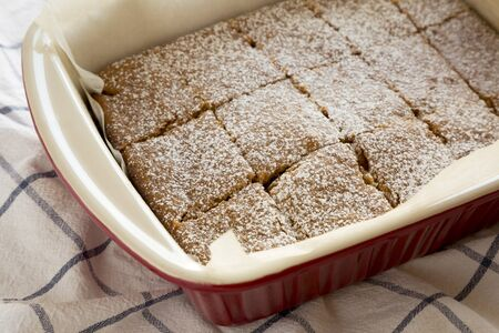 Homemade Tasty Applesauce Cake on a white wooden background, low angle view. Close-up. Standard-Bild