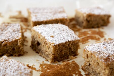 Homemade Tasty Applesauce Cake on a white plate, low angle view. Close-up.