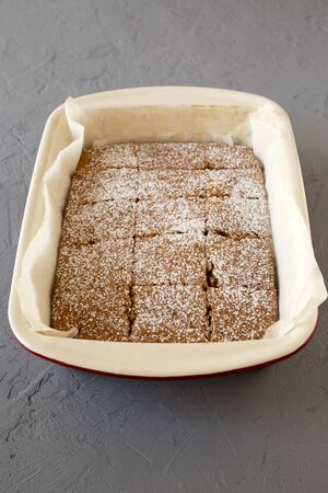 Homemade Tasty Applesauce Cake on a gray background, low angle view. Standard-Bild