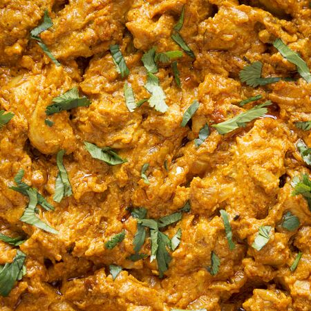 Homemade Chicken Tikka Masala background, top view. Flat lay, overhead, from above. Close-up.