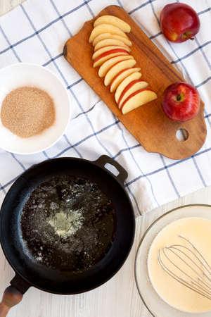 Cooking Apple Dutch Pannekoek Pancake on a white wooden surface, top view. Overhead, from above. Standard-Bild