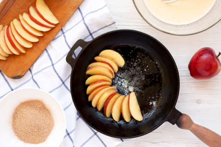 Cooking Apple Dutch Pannekoek Pancake on a white wooden background, top view. Overhead, from above. Standard-Bild