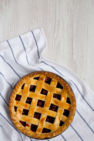 Yummy Homemade Cherry Pie on a white wooden background, top view. Flat lay, overhead, from above. Copy space.