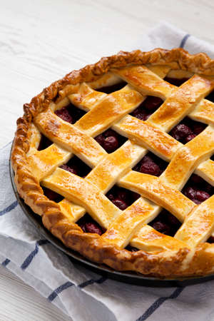 Yummy Homemade Cherry Pie on a white wooden surface, low angle view. Close-up. 写真素材