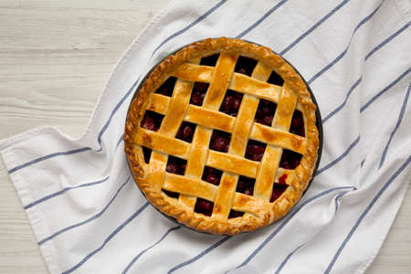 Yummy Homemade Cherry Pie in a baking dish, top view. Flat lay, overhead, from above. 写真素材