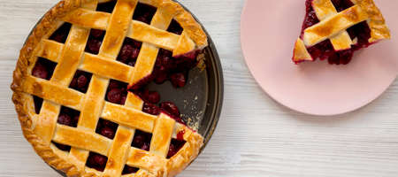 Yummy Homemade Cherry Pie on a white wooden background, top view. Flat lay, overhead, from above. 写真素材