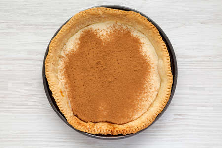 Homemade Sugar Cream Pie in a baking dish on a white wooden background, top view. Flat lay, overhead, from above. 写真素材