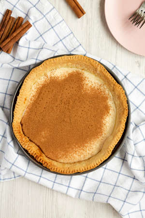 Homemade Sugar Cream Pie in a baking dish on a white wooden background, top view. Overhead, from above, flat lay. 写真素材