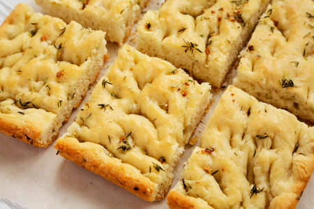 Home-baked Rosemary Garlic Focaccia Bread, close-up.