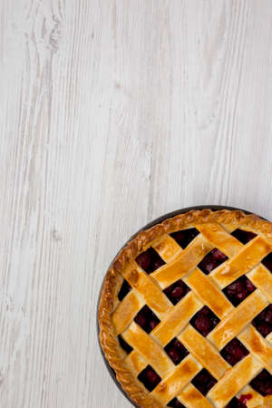 Yummy Homemade Cherry Pie on a white wooden background, top view. Flat lay, overhead, from above. Space for text. Reklamní fotografie