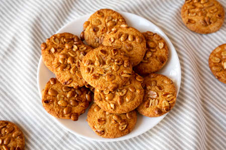 Homemade Cookies with Peanuts on a white plate, side view. Close-up. Stockfoto