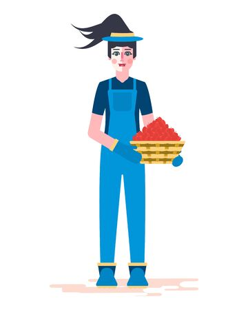 A girl in uniform - overalls, rubber boots and gloves, holds a basket of apples in her hands. Work on a personal plot.