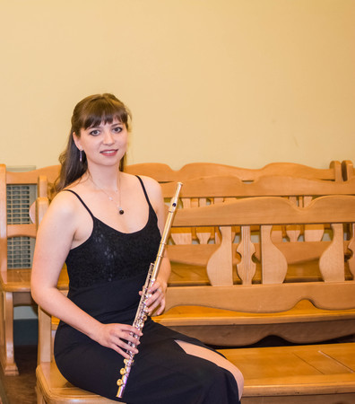 Beautiful girl in black dress with a flute Stock Photo