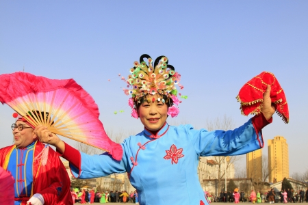 LUANNAN COUNTY OF HEBEI PROVINCE - FEBRUARY 18  During the Chinese Lunar New Year, people wear colorful clothes, yangko dance performances in the streets to express a new life of longing and yearning, on February 18, 2013, Luannan County, Hebei Province,