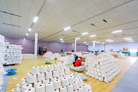 Luannan, November 20, 2012  Piles of spindles stacked together in a warehouse in the Zeao spinning company, in November 20, 2012, Luannan County, china  This is the largest of a modern spinning company in Hebei province