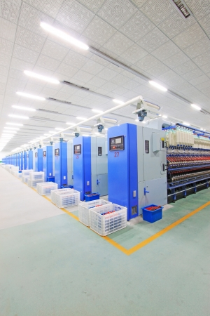 Luannan, November 20, 2012: Machinery and equipment in a spinning production line in the Zeao spinning company, in November 20, 2012, Luannan County, china. This is the largest of a modern spinning company in Hebei province.