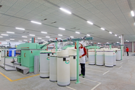 modernize: Luannan, November 20, 2012  Machinery and equipment in a spinning production line in the Zeao spinning company, in November 20, 2012, Luannan County, china  This is the largest of a modern spinning company in Hebei province